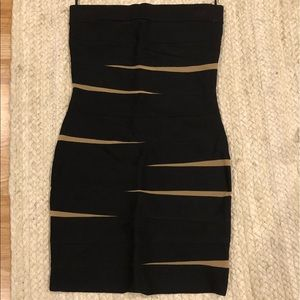 Bodycon black dress with mess cutouts